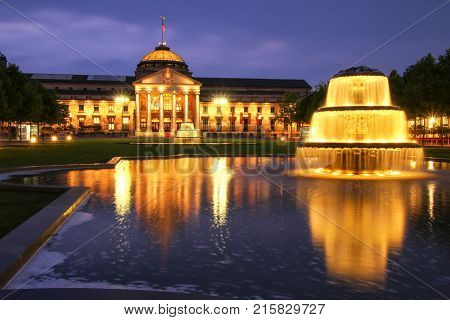Wiesbaden, Germany - May 24: Kurhaus And Bowling Green In The Evening With Lights On May 24, 2017 In