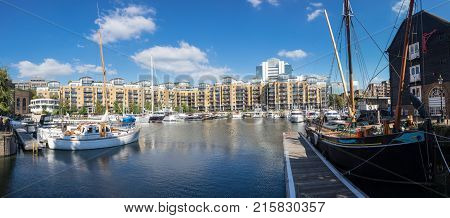LONDON, UK - OCTOBER 1, 2015: Broad panoramic view of the boats and barges in St Katherines Dock in London, England
