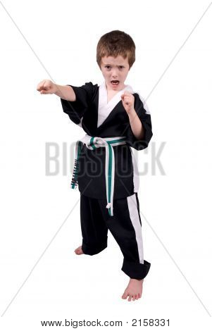Young boy Wearing Karate Outfit over a white background poster