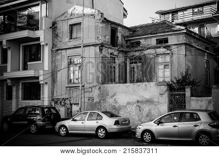 POMORIE BULGARIA - AUGUST 26 2017: Old and dilapidated house in the center of the seaside resort town of Pomorie. Black and white.