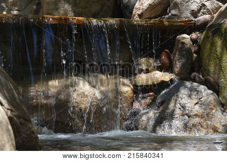 Waterfall in a small pond in a city park