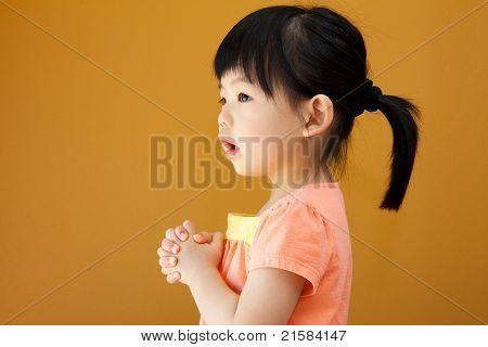 Asian Baby Child Girl Is Praying