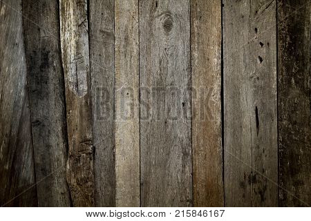 Wood vertical old. Reclaimed Old Wood Slats Rustic shabby Background. Home Interior Design Element In Modern Vintage Style. Hardwood Dark Brown Timbered Structure. Close Up