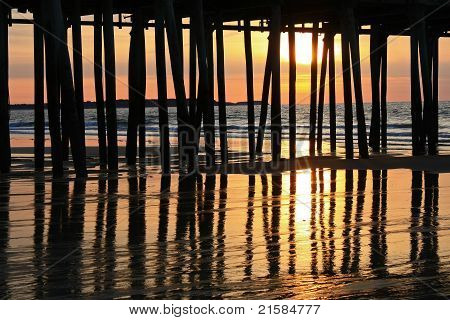 Ocean Sunrise Behind Pier