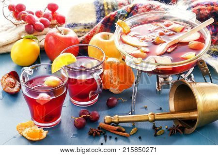 Boil mulled wine and punch. Glass jars with mulled wine. Spices, fruit. Hot wine for winter