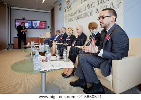 MOSCOW, RUSSIA - SEP 20, 2017: Employees of Cushman and Wakefield speek to representatives of business and profile media about commercial real estate market in 2018 during press-breakfast.