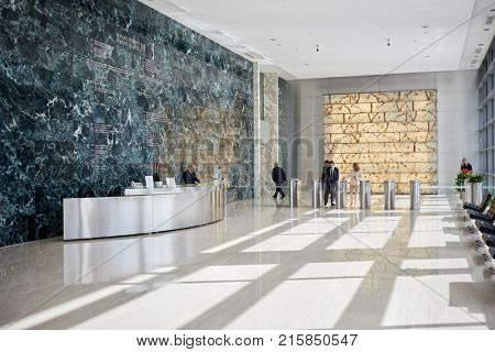 MOSCOW, RUSSIA - SEP 20, 2017: People in reception hall of Ducat Place III - one of the most famous and high-quality office centres in Moscow.