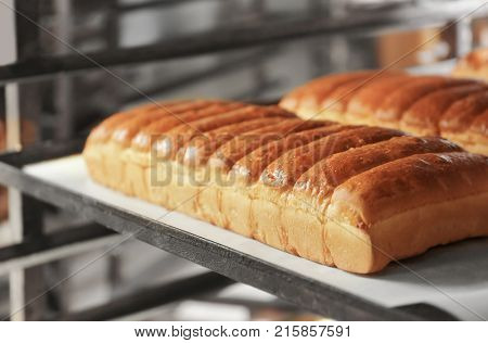 Loaves of bread on shelving in bakery