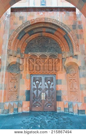 Abovyan, Armenia - December 31, 2016: Decorated Ornamental Entrance Door Made With Tuff Stones To Ar