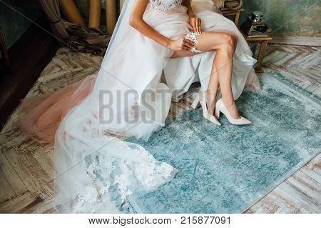 Garter On The Leg Of A Sexy Bride