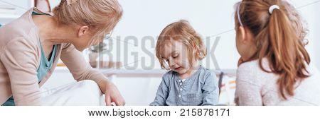 Friendly Teacher Listening Shy Kid