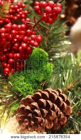 Christmas table decorations with holly pine cones mistletoe cedar cypress and juniper leaf springs