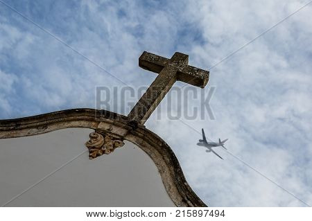 the plane is flying over the cross of church, a sign of superstition