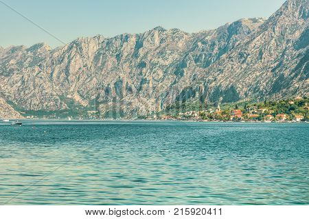 View of the Boka Kotorska Bay in the Adriatic Sea, the Balkan Mountains and a fragment of the city of Perast, Montenegro.