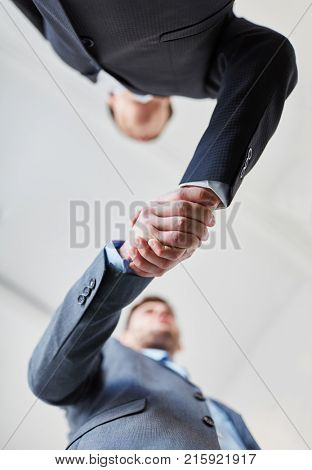 Business people shaking hands after closing a deal