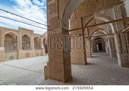 NAIN, IRAN - MAY 6, 2015: Arcade in inner courtyard of the old Jame mosque in Iran.