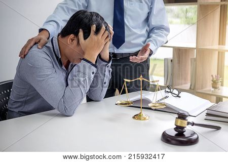 Judge gavel with scales of justice Business people and male lawyers discussing contract papers at law firm in office. Concepts of law.
