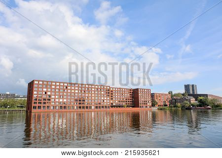 apartment block on Java island Amsterdam the netherlands - 19 September 2017: apartment buildings on water edge of Java Kade Java Island Amsterdam