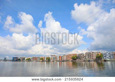 Java kade on Java island Amsterdam the netherlands - 19 September 2017: apartment buildings on water edge of Java Kade Java Island Amsterdam
