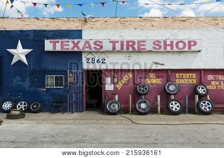 Forth Worth Texas - June 10 2014: The exterior of a tire shop with the Texas Flag painted in the facade in the city of Forth Worth Texas USA