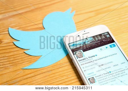 JYVASKYLA FINLAND - JUNE 13 2017: The official Twitter account of Donald Trump on mobile and printed logo. The American President has over 32 million followers on Twitter. Illustrative editorial.