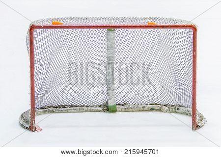a view of empty ice hockey net