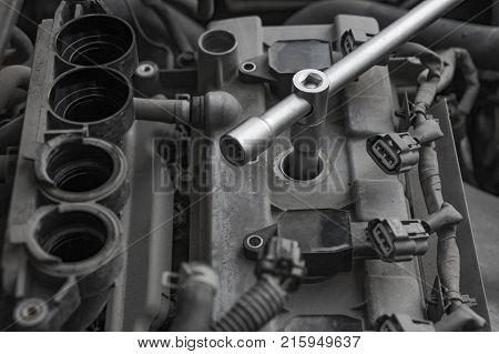 Car repair. Ignition system repair. Allen key inside. Repair of the old machine.
