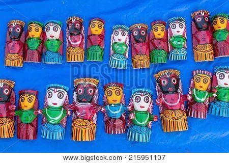 Dolls made of wood handicraft on display during Handicraft Fair in Kolkata - the biggest handicrafts fair in Asia.