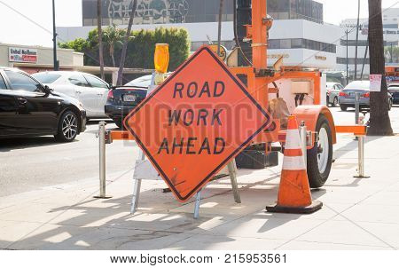 LOS ANGELES USA - AUGUST 18 2017: Road work ahead sign to block street lane and inform about construction in Beverly Hills. Editorial.