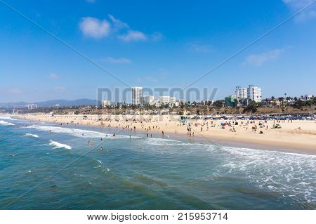 LOS ANGELES USA - AUGUST 18 2017: People enjoying nice summer day in Santa Monica Beach. The beach is 35 miles long and is very popular attraction in Los Angeles. Editorial.