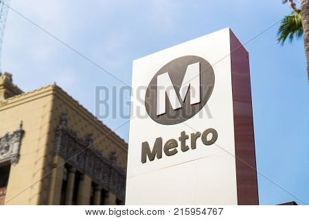 LOS ANGELES USA - AUGUST 25 2017: Metro logo and sign in Hollywood. LA Metro is the public rail and bus transportation system in Los Angeles. Editorial.