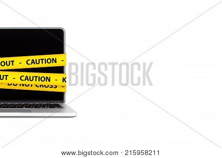 Caution And Keep Out Tapes On Laptop With Blank Screen
