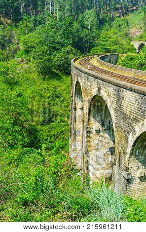 Nine Arch Bridge is the popular destination among the admirers of agritourism Demodara is rich in scenic tea plantations gardens and jungle Ella Sri Lanka.