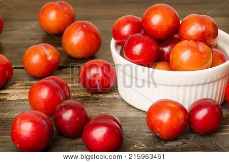 Fresh plum fruit (Julee) on wooden background, healthy fruit