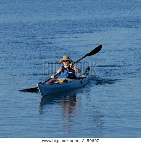 Attractive Young Female Kayaker Rowing