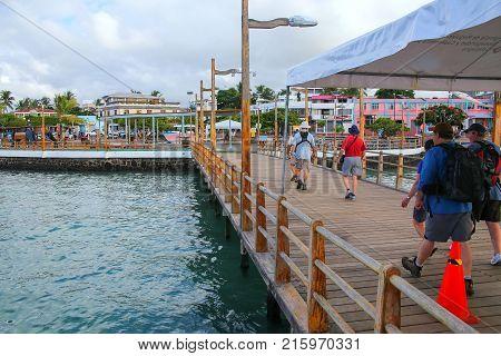 Santa Cruz, Ecuador - April 23: Unidentified People Walk On The Pier At Puerto Ayora On Santa Cruz I