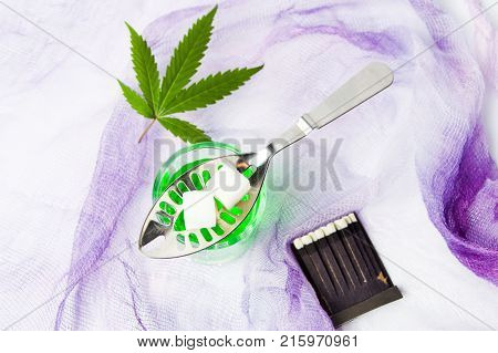 Absinthe alcohol drink with fresh marijuana leaf poster