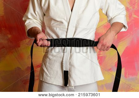 The Karate Fighter With Black Belt.