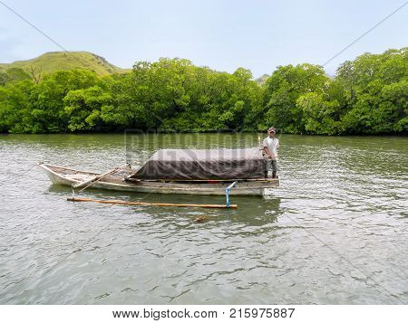 RINCA INDONESIA-MARCH 15: Jukung boat near Rinca Island in Komodo National Park on March 152012 in Nusa Tenggara Indonesia. Jukung is a small wooden Indonesian outrigger canoe.