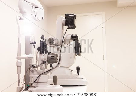 the cabinet of the eye doctor. slit lamp with cameram, autorefractometer and phoropter