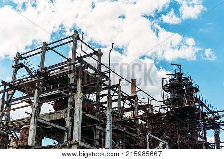 Industrial zone, equipment of factory, industrial pipelines of oil-refinery plant at blue sky background