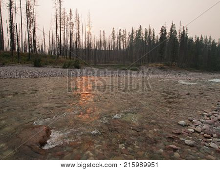 Sunset over the South Fork of the Flathead River at Meadow Creek Gorge in the Bob Marshall Wilderness complex during the 2017 fall fires in Montana United States poster