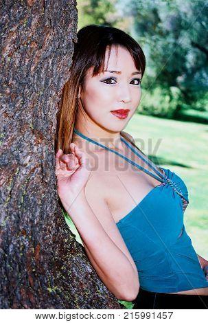 A lovely Asian female model posing outdoors