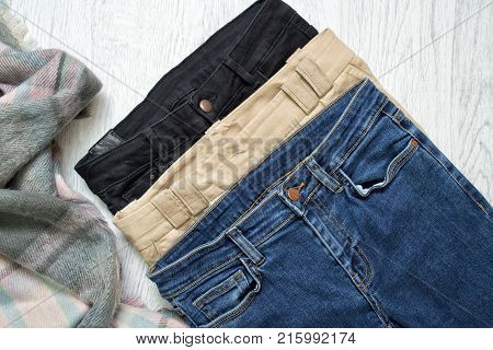 Three Jeans, Assortment. Blue, Beige And Black. Fashionable Concept