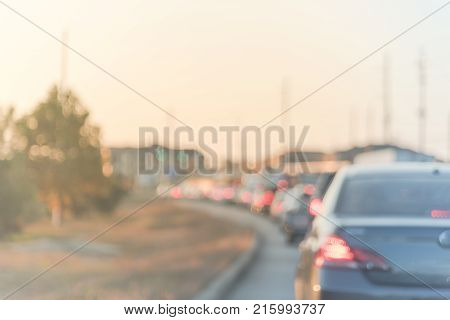 Blurred Busy Road With Long Line Of Cars Waiting At Stop Light In Houston, Texas, Usa