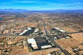 Aerial perspective of a desert landscape changing from rural to urban in Arizona poster