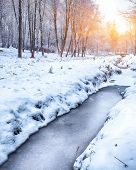 Scenic view of the frozen river. Frosty sunset poster