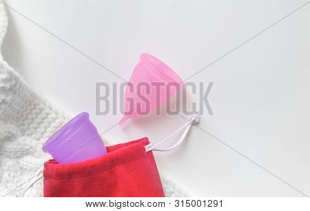 Two Silicone Menstrual Cups. Female Intimate Hygiene Products, Top View. Device For Collecting Blood
