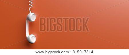 Old Phone Receiver On Orange Color Background. 3D Illustration
