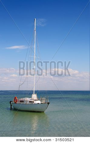 lonely boat at sea on the background of clouds